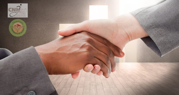 composite of shaking hands over office backgrounds